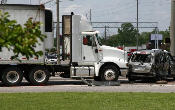 18-wheeler truck rear-ends car